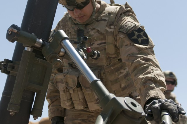 Pvt. Joshua Bakerink, who serves as a gunner with Alpha Company, 2nd Battalion, 1st Infantry Regiment, 2nd Stryker Brigade Combat Team, 2nd Infantry Division, sets his sights before firing the new 120mm Precision Guided Round during a training exercise at Forward Operating Base Terra Nova, Afghanistan, May 27, 2012.