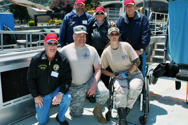 U.S. Army Corps of Engineers San Francisco District Commander Lt. Col. Torrey DiCiro, center, hosted several wounded warriors for some recreational therapy aboard The Dillard, one of the San Francisco District's vessels, May 29. The group toured the San Francisco Bay, saw famous engineering icons including the Golden Gate Bridge and Alcatraz and learned about the district's many missions, including keeping the bay navigable and safe.