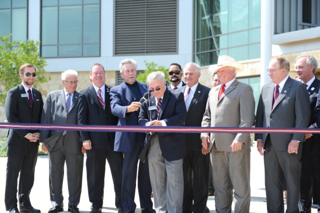 Texas A&M University Central Texas' President, Marc Nigliazzo, students, faculty, Board of Regents members and other supporters cut the ribbon with a 1st Cavalry Division saber in front of TAMUCT's first campus building in Killeen, Texas, May 24, 2012.