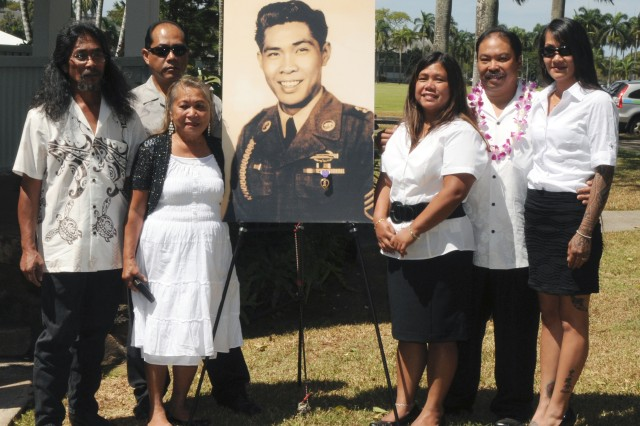Family members gather around a portrait of retired Sgt. 1st Class Alepio Solmirin, who was posthumously awarded the Purple Heart for an injury he received during the Korean War. Lt. Gen Francis J. Wiercinski, commanding general of U.S. Army Pacific, officiated the ceremony June 1, 2012, at Palm Circle located at Fort Shafter, Hawaii.