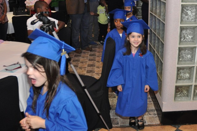 Strong Beginnings children enter R&R Bar and Grill as they graduate the program, June 1. Yongsan Child, Youth and School Services held a Child Development Center Commencement Ceremony for pre-kindergarten kids to make their new beginning special. Children were excited for their graduation and made their parents proud. (U.S. Army photo by Pfc. Lee Hyokang)