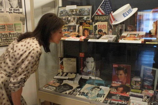 A visitor peruses a case full of Elvis memorabilia at the folk museum in Burglengenfeld, May 11.