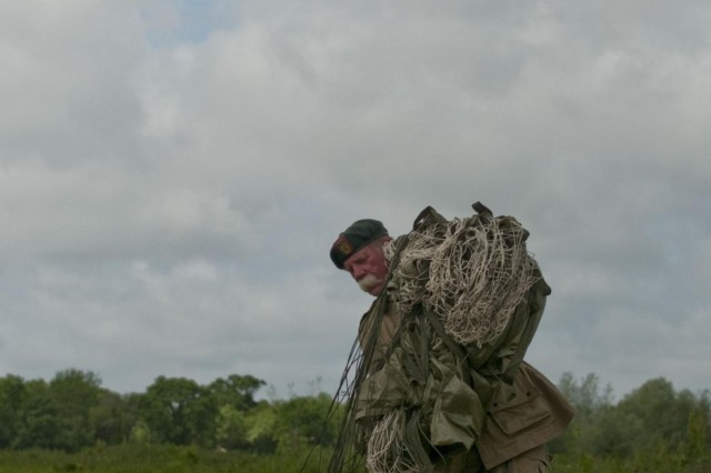 David DeSoucy, retired veteran and Liberty Jump Team member, packs up his parachute after completing a jump onto La Fiere drop zone in France in honor of D-Day celebrations, June 3, 2012. Task Force 68, which is made up of paratroopers from U.S., Germany, France, Holland, and United Kingdom, re-enacted the D-Day airborne operation on the La Fiere fields near Ste. Mere Eglise, France, to commemorate the heroic acts of the World War II paratroopers who made the jump 68 years ago. After the jump, the task force marched into the town of Ste. Mere Eglise to the sounds of cheers from the locals. Task Force 68 is in Normandy, France, to commemorate the 68th anniversary of D-Day.