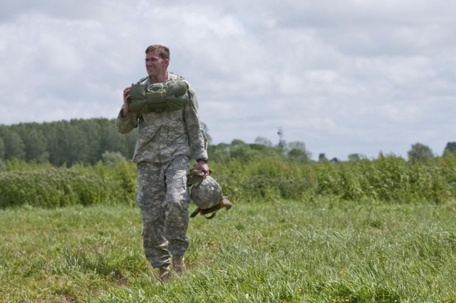 Capt. Henry Lifton, 2nd Brigade, 82nd Airborne Division, walks of the La Fiere drop zone in France, after jumping in honor of D-Day, June 3, 2012. Task Force 68, which is made up of paratroopers from U.S., Germany, France, Holland, and United Kingdom, re-enacted the D-Day airborne operation on the La Fiere fields near Ste. Mere Eglise, France, to commemorate the heroic acts of the World War II paratroopers who made the jump 68 years ago. After the jump, the task force marched into the town of Ste. Mere Eglise to the sounds of cheers from the locals. Task Force 68 is in Normandy, France, to commemorate the 68th anniversary of D-Day.