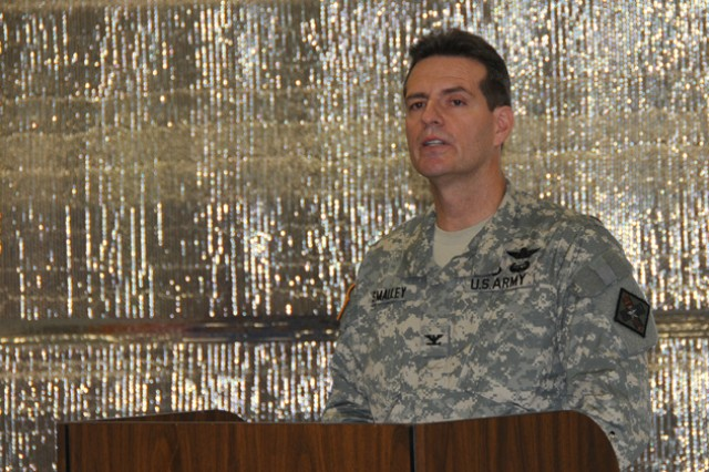 Col. Brian Smalley, dean of the U.S. Army School of Aviation Medicine, speaks during the USASAM change of dean ceremony at the Aviation Medical School's new facility May 24.