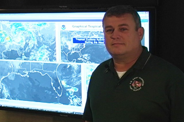 Willie Worsham, Fort Rucker battle captain, shows how the IOC can track weather systems as far out as almost two weeks.