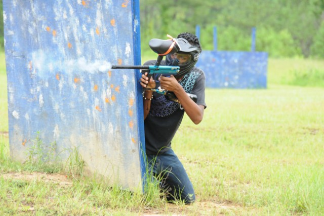 Jesus Figueroa, military Family member, fires at an opposing team member last year at the Dothan Survival Games paintball field at Lake Tholocco's West Beach.