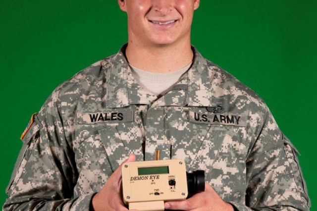 "1st Lt. Derek Wales (shown in photo prior to his promotion) shows his ""DemonEye,"" designed to provide Soldiers fast grid coordinates on the battlefield with a product that can be produced at a relatively low cost."