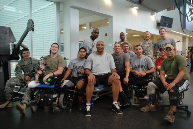 "Charles Barkley, a former professional basketball player and an analyst on TNT's ""Inside the NBA,"" poses with wounded warriors during a visit to the Center for the Intrepid in San Antonio, June 4, 2012. The Center for the Intrepid is a state-of-the-art rehabilitation facility for service members injured while supporting operations Enduring and Iraqi Freedom."