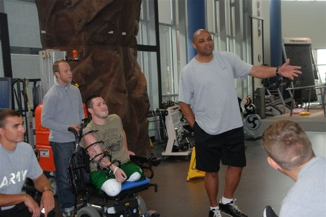 """Charles Barkley, a former professional basketball player and an analyst on TNT's """"Inside the NBA,"""" banters with wounded warriors during a visit to the Center for the Intrepid in San Antonio, June 4, 2012."""
