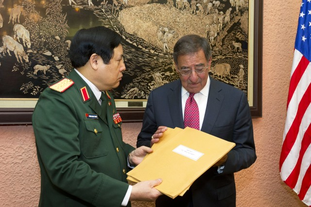 U.S. Defense Secretary Leon E. Panetta accepts letters from Vietnamese Defense Secretary Phung Quang Thanh, in Hanoi, Vietnam, June 4, 2012. The letters were written by American service members from the Vietnam war. The Vietnamese government will open three areas to help resolve the fate of Americans missing in action from the Vietnam War.