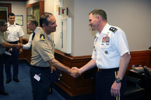 Maj. Gen. Perry Wiggins, commanding general, First Army Division West, Fort Hood, Texas, welcomes Mexican Lt. Gen. Gerardo Ruben Serrano Herrera, director, military industry, on behalf of Army North, to the official part of the Pentagon visit May 22, 2012, as part of the Fifth Army Inter-American Relations Program visit May 21-25. Wiggins has extensive experience with FIARP after serving as Army North's deputy commanding before moving on to his current position.