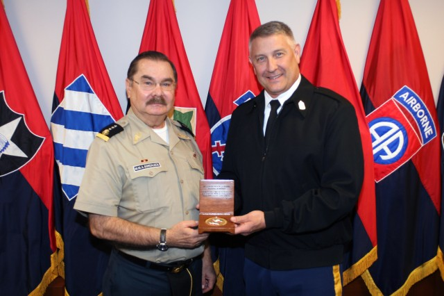 Mexican Lt. Gen. Mario Marco Antonio Gonzalez Barreda, inspector general/comptroller, National Defense Secretariat, is presented a gift by Sergeant Major of the Army Raymond Chandler III May 22, 2012, as part of the Army North-hosted Fifth Army Inter-American Relations Program visit May 21-25.