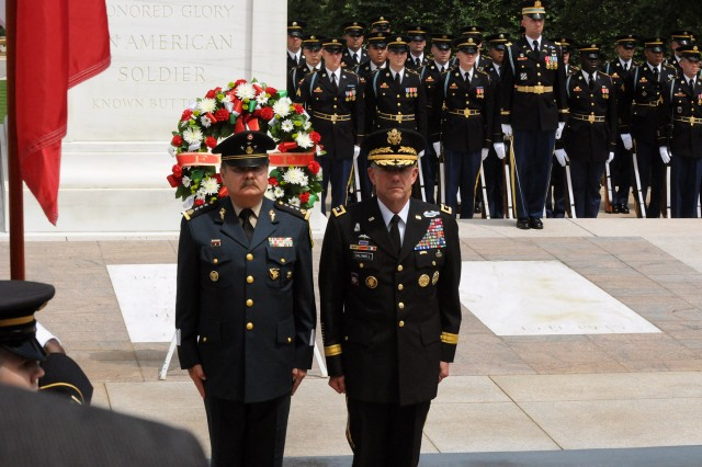 Lt. Gen. William Caldwell IV, commanding general of U.S. Army North and senior mission commander, Fort Sam Houston and Camp Bullis, Texas, walks solemnly alongside his counterpart, Mexican Lt. Gen. Mario Marco Antonio Gonzalez Barreda, inspector general/comptroller, National Defense Secretariat, after the laying of a wreath at the Tomb of the Unknowns, May 22, 2012, at Arlington National Cemetery, Va., in honor of the Fifth Army Inter-American Relations Program.