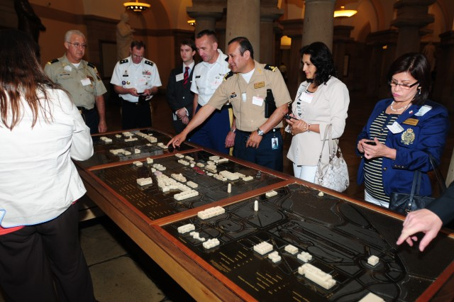 Members of the Mexican delegation, hosted by U.S. Army North, admire a model of the capital area during their tour of the Capitol building in Washington, D.C., May 23, 2012, as part of the Fifth Army Inter-American Relations Program. The model was representative of the national mall area between the White House and the Washington Monument.