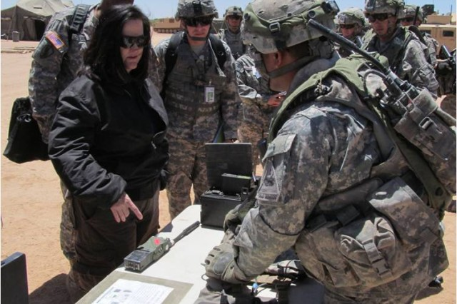 Hon. Katherine Hammack, assistant secretary of the Army for installations, energy and environment asks Soldiers of the 1st Battalion/6th Infantry, 1st Armored Division about some of the equipment being evaluated during NIE 12.2.
