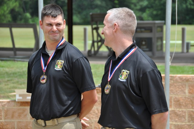 Staff Sgt. Michael McPhail (left) and Sgt. 1st Class Eric Uptagrafft, U.S. Army Marksmanship Unit, share a laugh during the awards ceremony June 5, 2012, at Hook Range on Fort Benning, Ga. McPhail won the U.S. Olympic Team Trials Rifle Prone match, earning his first berth to the Olympics. He will join Uptagrafft, who had qualified for the same event last year. McPhail and Uptagrafft will shot Aug. 3, 2012, for a gold medal.