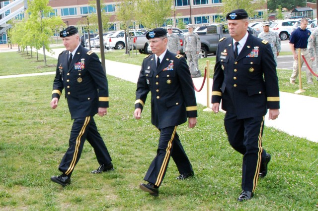 FORT EUSTIS, Va. -- Gen. Robert W. Cone, commanding general of U.S. Army Training and Doctrine Command; Lt. Gen. John E. Sterling, outgoing deputy commanding general of TRADOC and Lt. Gen. David D. Halverson, incoming TRADOC DCG, enter the field at the DCG change of responsibility ceremony June 4. Sterling retired after 36 years of service. (U.S. Army photo by Sgt. Steven Schneider)