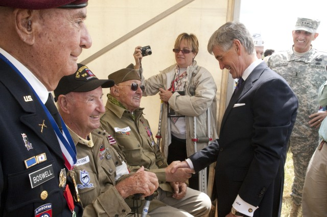 Secretary of the Army John McHugh speaks to WWII veterans June 3, 2012, including John Perrozi (shaking McHugh's hand), who was an 82nd Airborne Division paratrooper on D-Day.  Perozzi received France's highest military medal, the Légion d'Honneur, later in the day during the D-Day commemoration event near Sainte Mere Eglise, France.  Thousands of spectators joined veterans to observe the multi-national airborne operation honoring Allied paratroopers who participated in D-Day and went on to liberate Sainte Mere Eglise.