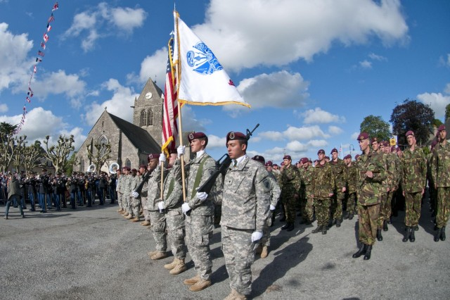 Task Force 68, which is made up of paratroopers from U.S., Germany, France, Holland, and United Kingdom, re-enacted the D-Day airborne operation on the La Fiere fields near Ste. Mere Eglise, France, to commemorate the heroic acts of the World War II paratroopers who made the jump 68 years ago. After the jump, the task force marched into the town of Ste. Mere Eglise to the sounds of cheers from the locals. Task Force 68 is in Normandy, France, to commemorate the 68th anniversary of D-Day.