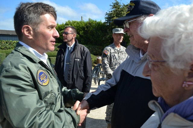 Charles Rivkin, U.S. ambassador to France, meets with John Roman, a D-Day veteran, and his wife Jacqueline, during the June 3, 2012, commemorations in Normandy, France. Rivkin jumped into the nearby drop zone with the U.S. Army's Golden Knights.