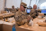 233rd Trans. Co. Soldiers help to reduce waste at Retro-Sort yard