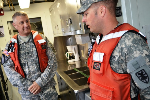 Sgt. Maj. of the Army Raymond F. Chandler III, left, learns about the unique challenges faced by Soldiers assigned to an Army tugboat from Sgt. 1st Class Michael Griffin, right, a tugboat vessel master assigned to the 73rd Transportation Company, 10th Transportation Battalion, 7th Sustainment Brigade, during a visit to 3rd Port on Fort Eustis, Va., June 5, 2012.