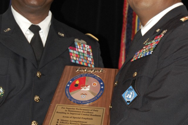 General Lloyd J. Austin III (left), Army Vice Chief of Staff, presents an award to CW2 Terrence Devone, United Nations Command Security Battalion-Joint Security Area, Camp Bonifas, Kora.  His unit won the top honor in the maintenance category during the 2012 Combined Logistics Excellence Awards (CLEA) ceremony.