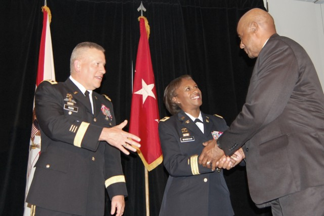 Lieutenant General Raymond Mason (left), Deputy Chief of Staff for Logistics, and Brigadier General Gwen Bingham, Quartermaster School Commandant, congratulates a representative from the Womack Army Medical Center, Fort Bragg, North Carolina.  The unit won the top honor in the supply category during the 2012 Combined Logistics Excellence Awards (CLEA) ceremony.