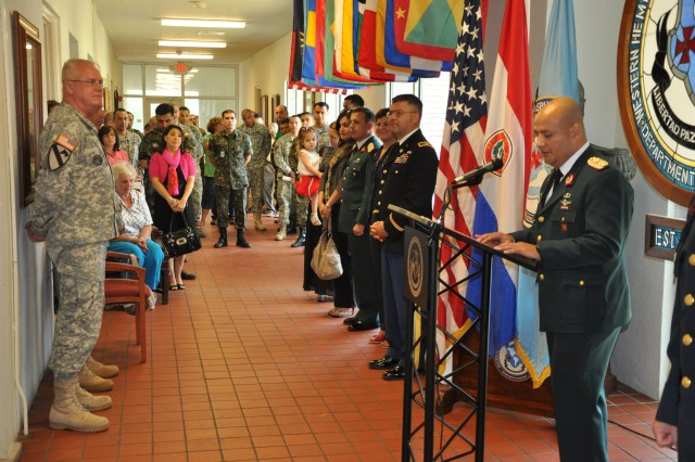 Brig. Gen. Douglas Satterfield, deputy commander, 412th Theater Engineer Command, participates in the celebration of Paraguay's Independence Day during a visit to the Western Hemisphere Institute for Security Cooperation at Fort Benning, Ga., May 15, 2012. Speaking at the podium is Maj. Paul Nuñez, Partner Nation Instructor from Paraguay.