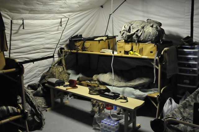 The interior of one of the energy efficient tents at the energy efficient base camp housing Soldiers from Task Force Muleskinner shows how the tents are loaded with personnel and equipment in real-world usage. The Energy Initiative Proving Ground will provide data for equipment being used in realistic conditions to evaluate the effectiveness of several energy efficiency strategies being tested for use in Operation Enduring Freedom.