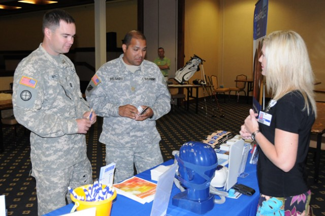 Capt. Dave Winter and Maj. Jesse Delgado, B Co., 1st Bn., 212th Avn. Regt., get information about sleep disorders from Dana Florea, Southeast Medical Center account executive, at last year's Men's Sports, Fitness and Wellness Expo. This year's Men's Health and Fitness Expo takes place June 14 from 10 a.m. to 2 p.m. at the Fort Rucker Physical Fitness Facility.