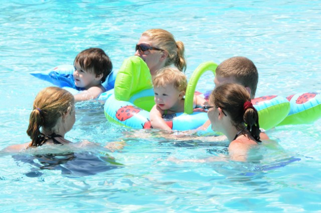 A Family drifts through the shallow end of the pool at Splash! June 4.