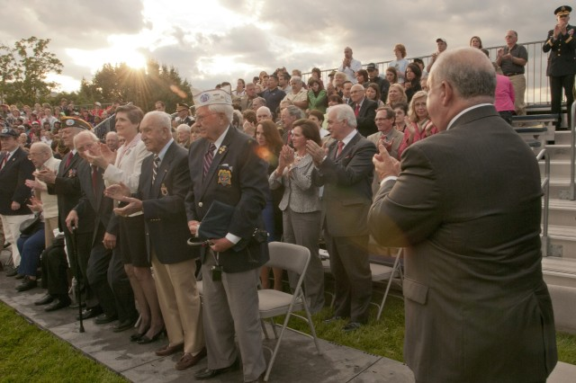 """Under Secretary of the Army Joseph W. Westphal (lower right) and a crowd of more than three thousand people applaud World War II veterans at a recent """"Twilight Tattoo"""", June 6, 2012, at Joint Base Myer-Henderson Hall, Va. The theme of the ceremony was """"Saluting World War II Veterans on the 68th Anniversary of D-Day"""". Twilight Tattoo is an hour-long military pageant featuring Soldiers from the 3rd U.S. Infantry Regiment (The Old Guard) and The U.S. Army Band """"Pershing's Own."""" For more information go to http://twilight.mdw.army.mil/ (U.S. Army photo by Staff Sgt. Bernardo Fuller)"""