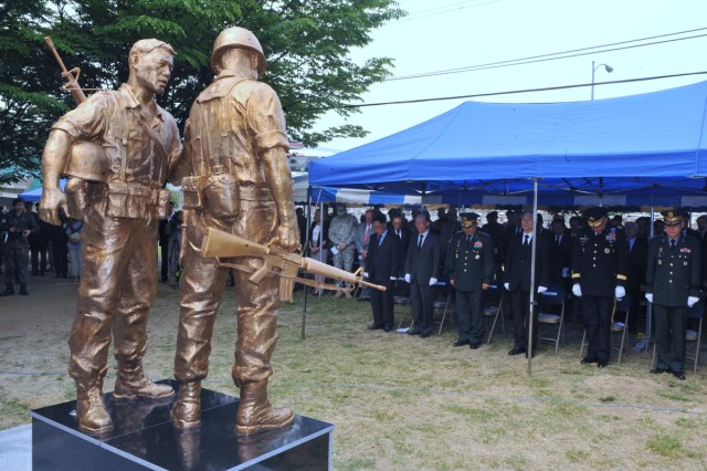 Senior ROK-U.S. Alliance pause for a moment of silence June 8, 2012, during a dedication ceremony for a monument that honors the American troops and Korean Augmentees to the U.S. Army who have died defending freedom since the Korean War Armistice was signed.