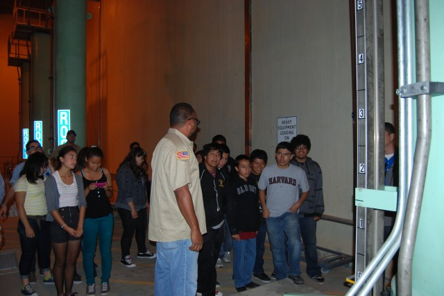 Lawrence Watkins, the dam tender at Prado Dam, gives math, science and technology students from Roosevelt High School a tour of the lower level of the dam's control tower.     Read more: http://www.dvidshub.net/image/595935/students-visit-prado-dam#ixzz1xE4EzBeB