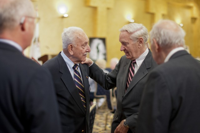 """World War II veteran Alfred H. M. Shehab (middle - left) recollecting his time spent during the war with other veterans and guests during a reception in honor of World War II veterans, in advance of a """"Twilight Tattoo"""" ceremony, June 6, 2012 at Joint Base Myer-Henderson Hall, Va.  The event was held in conjunction with the 68th anniversary of the Allied invasion of Normandy, France, June 6, 1944.  The theme of the ceremony was """"Saluting World War II Veterans on the 68th Anniversary of D-Day"""".  Twilight Tattoo is an hour-long military pageant featuring Soldiers from the 3rd U.S. Infantry Regiment (The Old Guard) and The U.S. Army Band """"Pershing's Own.""""  For more information go to http://twilight.mdw.army.mil/ (U.S. Army photo by Staff Sgt. Bernardo Fuller)"""