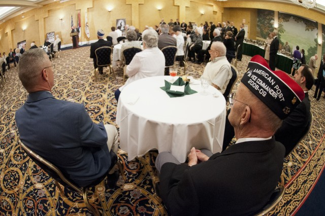 """World War II veteran Frederick Griswold (lower right) along with other veterans and guests listen to the Under Secretary of the Army Joseph W. Westphal during a reception in honor of World War II veterans, in advance of a """"Twilight Tattoo"""" ceremony, June 6, 2012 at Joint Base Myer-Henderson Hall, Va.  The event was held in conjunction with the 68th anniversary of the Allied invasion of Normandy, France, June 6, 1944.  The theme of the ceremony was """"Saluting World War II Veterans on the 68th Anniversary of D-Day"""".  Twilight Tattoo is an hour-long military pageant featuring Soldiers from the 3rd U.S. Infantry Regiment (The Old Guard) and The U.S. Army Band """"Pershing's Own.""""  For more information go to http://twilight.mdw.army.mil/ (U.S. Army photo by Staff Sgt. Bernardo Fuller)"""