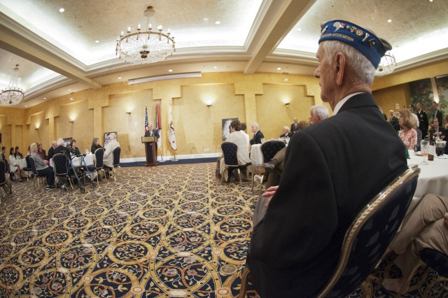 """World War II veteran Walter W. Heline (lower right) along with other veterans and guests listen to the Under Secretary of the Army Joseph W. Westphal during a reception in honor of World War II veterans, in advance of a """"Twilight Tattoo"""" ceremony, June 6, 2012 at Joint Base Myer-Henderson Hall, Va.  The event was held in conjunction with the 68th anniversary of the Allied invasion of Normandy, France, June 6, 1944.  The theme of the ceremony was """"Saluting World War II Veterans on the 68th Anniversary of D-Day"""".  Twilight Tattoo is an hour-long military pageant featuring Soldiers from the 3rd U.S. Infantry Regiment (The Old Guard) and The U.S. Army Band """"Pershing's Own.""""  For more information go to http://twilight.mdw.army.mil/ (U.S. Army photo by Staff Sgt. Bernardo Fuller)"""