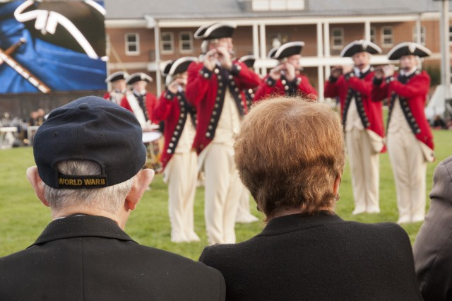 """A World War II veteran watches members of the 3d U.S. Infantry Regiment (The Old Guard) Fife and Drum Corps, march on to the field at a recent """"Twilight Tattoo"""" June 6, 2012, at Joint Base Myer-Henderson Hall, Va.  The theme of the ceremony was """"Saluting World War II Veterans on the 68th Anniversary of D-Day"""".  Twilight Tattoo is an hour-long military pageant featuring Soldiers from the 3rd U.S. Infantry Regiment (The Old Guard) and The U.S. Army Band """"Pershing's Own.""""  For more information go to http://twilight.mdw.army.mil/ (U.S. Army photo by Staff Sgt. Bernardo Fuller)"""