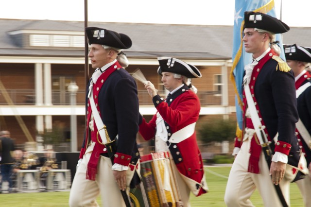 """Members of the 3d U.S. Infantry Regiment (The Old Guard) Fife and Drum Corps, march on to the field at a recent """"Twilight Tattoo"""" June 6, 2012, at Joint Base Myer-Henderson Hall, Va.  The theme of the ceremony was """"Saluting World War II Veterans on the 68th Anniversary of D-Day"""".  Twilight Tattoo is an hour-long military pageant featuring Soldiers from the 3rd U.S. Infantry Regiment (The Old Guard) and The U.S. Army Band """"Pershing's Own."""" For more information go to http://twilight.mdw.army.mil/  (U.S. Army photo by Staff Sgt. Bernardo Fuller)"""