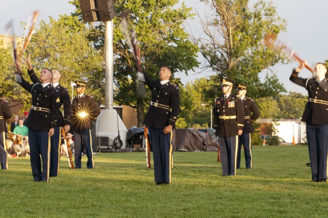 """Members of the United States Army Drill Team perform for a crowd of more than three thousand people at a recent """"Twilight Tattoo"""" June 6, 2012, at Joint Base Myer-Henderson Hall, Va. The theme of the ceremony was """"Saluting World War II Veterans on the 68th Anniversary of D-Day"""".  Twilight Tattoo is an hour-long military pageant featuring Soldiers from the 3rd U.S. Infantry Regiment (The Old Guard) and The U.S. Army Band """"Pershing's Own."""" For more information go to http://twilight.mdw.army.mil/  (U.S. Army photo by Staff Sgt. Bernardo Fuller)"""