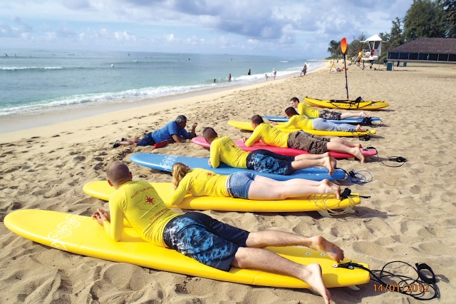 Members of an ADventure surf instruction class receive instruction at White Plains Beach, recently. Monthly surfing and paddleboard classes begin and end at the Schofield Barracks Outdoor Recreation Center. Class size is limited to 12 participants. Instruction locations vary due to conditions and time of year.