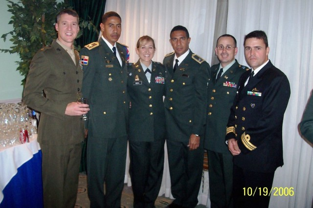 Lt. Col. Victor Green (Second from Right), 412th Theater Engineer Command, with classmates at a reception at the InterAmerican Defense University in 2006. Green at the time was attending the resident ILE course at the Western Hemisphere Institute for Security Cooperation atFort Benning, Ga.