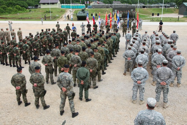 A mass formation of soldiers from eight different NATO partner nations including U.S. Army Europe's 2nd Cavalry Regiment is held during the closing ceremonies of the Immediate Response 2012 training event held in Slunj, Croatia, June 9.