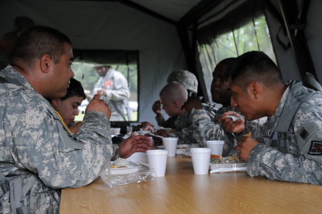 Soldiers enjoy a hot meal prepared by the 926 BN FSC Food Service team June 9, 2012 in Birmingham, Ala. USARC was on site to evaluate the Food Service and Field Sanitation team for a slot to compete in this year's Connelly Awards competition.