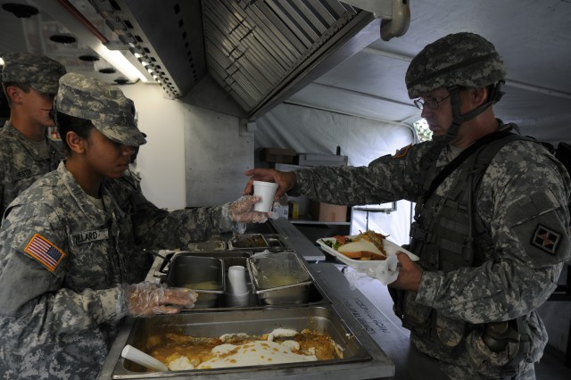 The 926 BN FSC Food Service team serves up a hot meal as part of their tactical feeding evaluation by USARC June 9, 2012 in Birmingham, Ala. The 9-Soldier team has a chance to compete in this year's Connelly Awards competition.