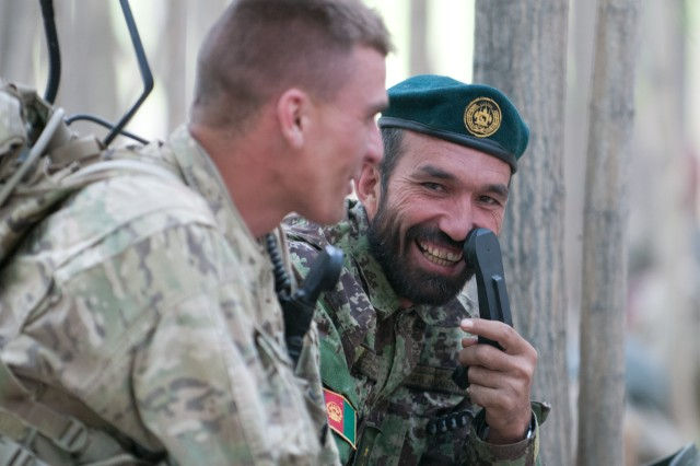 First Lt. Laska Khan, an officer with the Afghan National Army's 203rd Corps, laughs with 1st Lt. Kirk Shoemaker, a platoon leader with the 82nd Airborne Division's 1st Brigade Combat Team, during a break in a three-day combat operation June 4, 2012, Ghazni Province, Afghanistan.