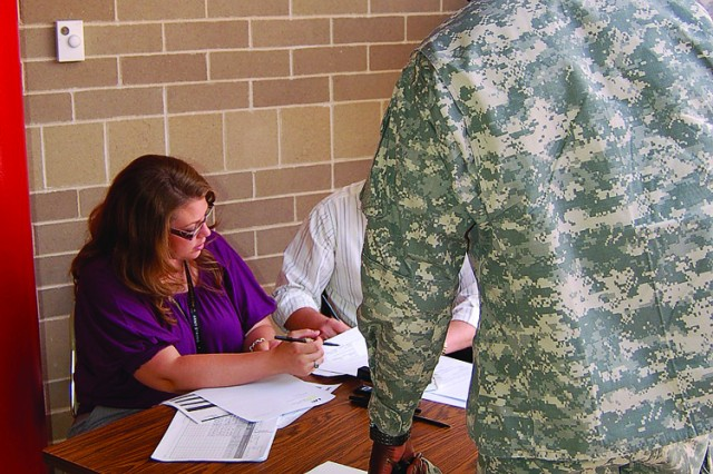 LHI employees check in a Soldier during the Milwaukee Recruiting Battalion's medical processing event.
