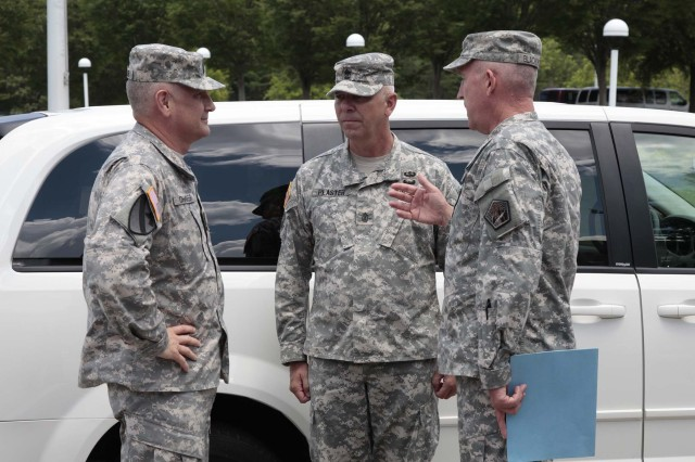 Army Cyber Command senior noncommissioned officers, Command Sgt. Maj. Roger Blackwood, right, and Sgt. Maj. John Plaster, G-3 senior enlisted advisor, greet Sergeant Major of the Army Raymond Chandler upon his visit to Army Cyber Command Headquarters at Fort Belvoir, June 7, 2012.